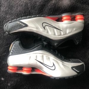 Black and Silver Nike Shocks